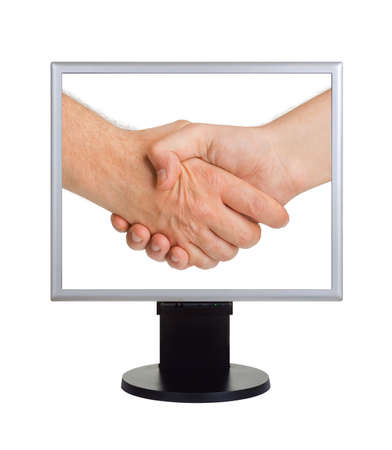 Handshake on computer screen isolated on white background photo