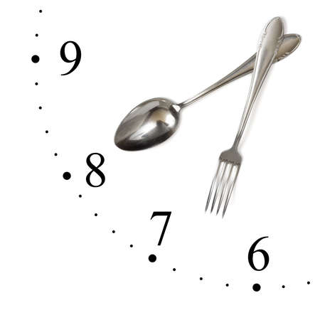 Clock made of spoon and fork isolated on white background Stock Photo - 4950273