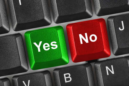yes button: PC keyboard with Yes and No keys - business concept