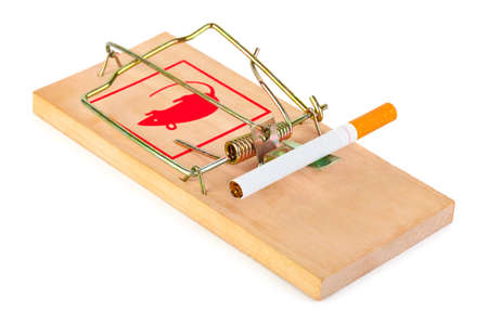 Mousetrap and cigarette isolated on white background photo