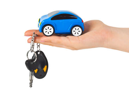 Hand with keys and car isolated on white background Stock Photo - 4999616