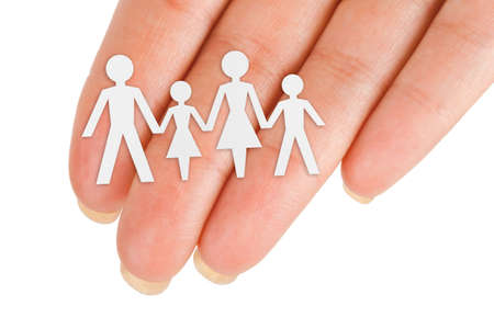Paper family in hand isolated on white background photo