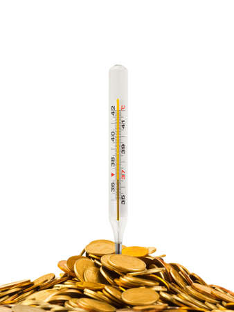 Coins and thermometer isolated on white background photo