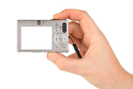 Photo camera in hand isolated on white background Stock Photo - 5065998