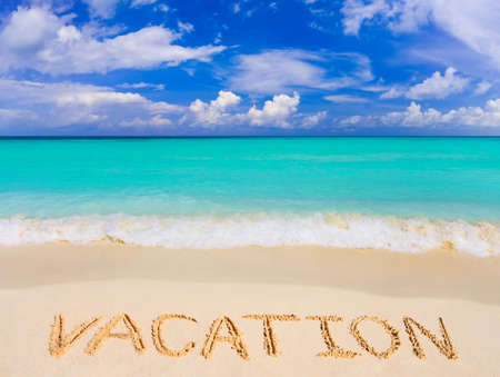 Word Vacation on beach - concept travel background photo