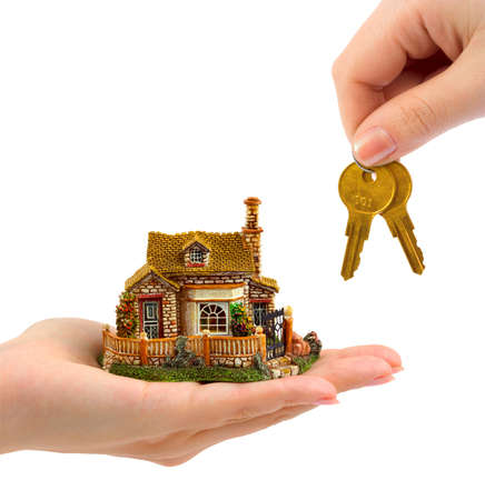 Hands with house and keys isolated on white background photo