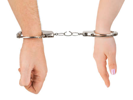jail break: Man and woman hands and breaking handcuffs isolated on white background Stock Photo