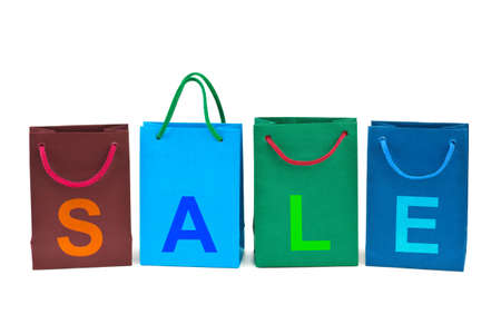 Shopping bags and word Sale isolated on white background photo