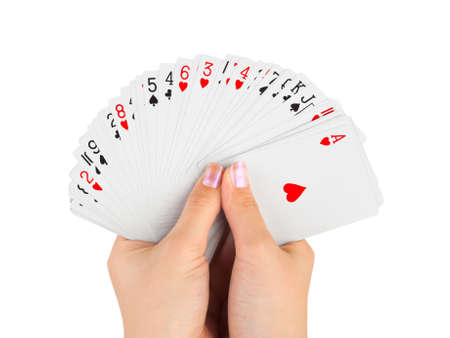 playing with money: Hands and playing cards isolated on white background