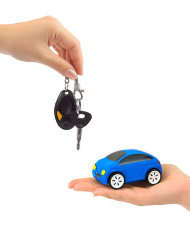 Hands with keys and toy car isolated on white background photo