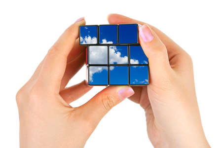 Hands with sky puzzle isolated on white background photo