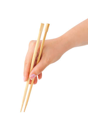 Hand with chopsticks isolated on white background photo
