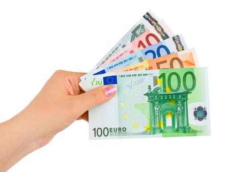 Hand with euro money isolated on white background photo