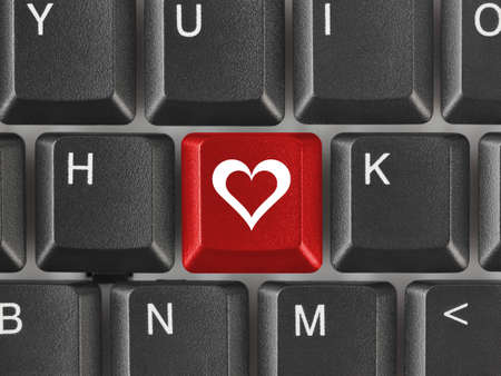 love symbols: Computer keyboard with love key - internet concept