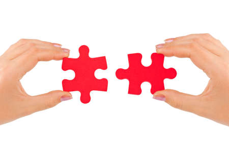love strategy: Hands and puzzle isolated on white background