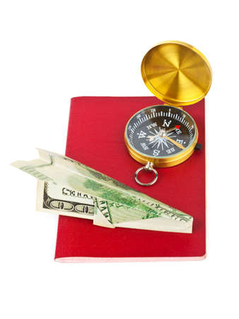 Passport, compass and money plane - travel concept isolated on white background photo