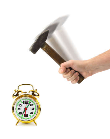 Hand with hammer and alarm clock isolated on white background photo