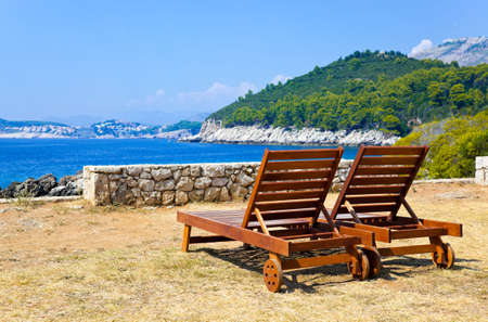 longue: Longue on beach in Dubrovnik, Croatia  - abstract vacations background