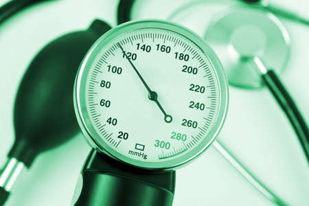 Scale of pressure and stethoscope - abstract medical background photo