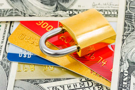 Credit cards, money and lock - business security background photo