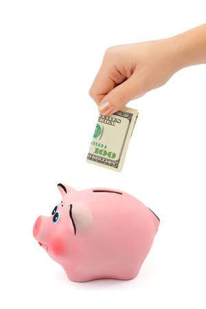 Hand with money and piggy bank isolated on white background photo