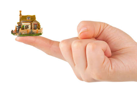 Hand and small house isolated on white background photo