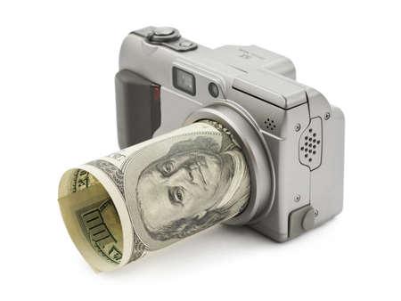 Photo camera and money isolated on white background photo
