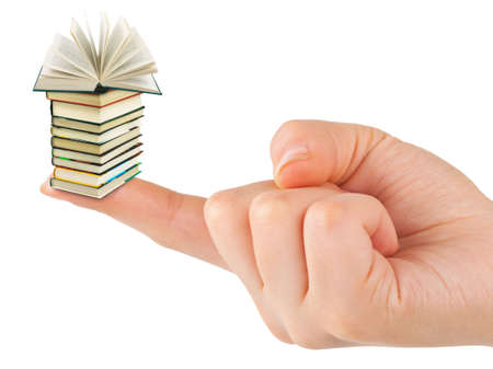 Hand and small books isolated on white background photo