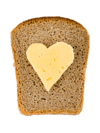 Bread and heart shaped cheese isolated on white background photo