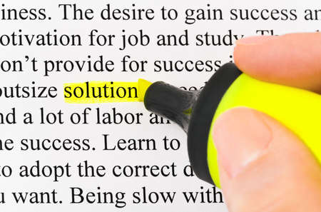 Hand with highlighter and word solution - concept business background photo
