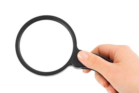 Magnifying glass in hand isolated on white background Stock Photo - 5624214