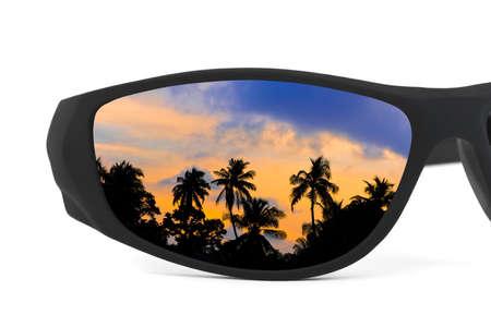 Sunglasses and sunset reflection isolated on white background photo