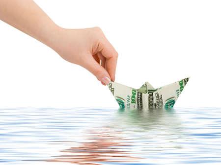 Hand launching money ship isolated on white background Stock Photo - 5663370