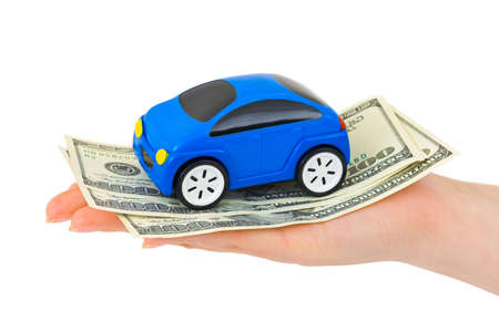 Hand with money and toy car isolated on white background photo