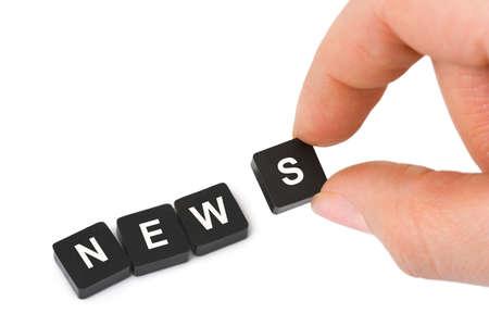 Hand und Wort isoliert News auf wei�en Hintergrund