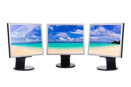 Panorama of beach on computer screens isolated on white background photo