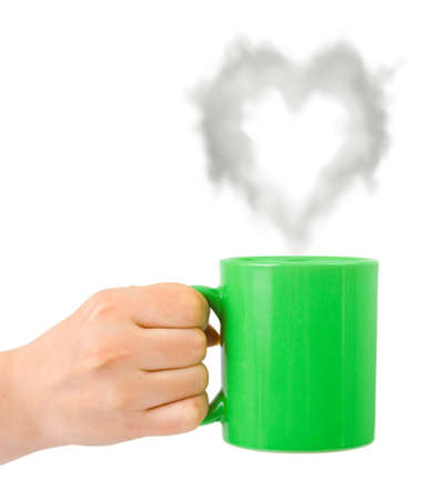 Hand with cup and steam like a heart isolated on white background photo