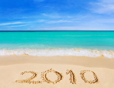 Numbers 2010 on beach - concept holiday background Stock Photo