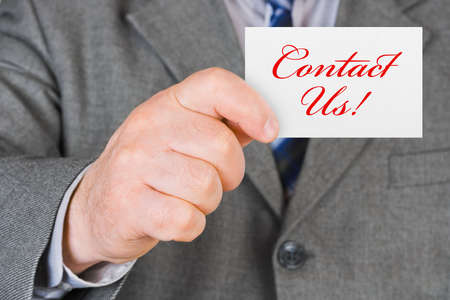 Card Contact us in hand - business background Stock Photo - 5786488