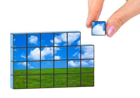 environment issues: Hand and nature puzzle (my photo) isolated on white background Stock Photo