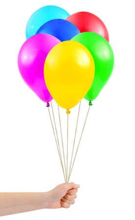 air bladder: Palloncini multicolori in mano isolato su sfondo bianco  Archivio Fotografico