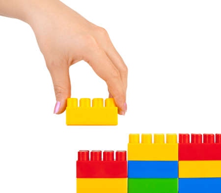 Hand and toy wall isolated on white background Stock Photo - 5889284
