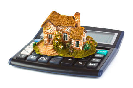 Calculator and house isolated on white background Stock Photo - 5906804