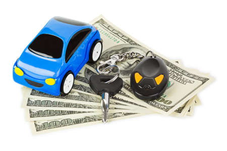 Toy car, keys and money isolated on white background photo