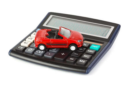 auto insurance: Calculator and toy car isolated on white background