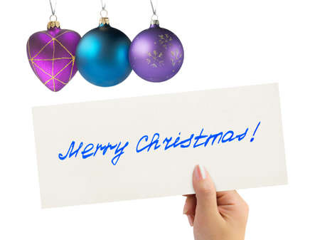 Christmas greeting card in hand isolated on white background photo