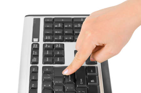 Computer keyboard and hand isolated on white background photo