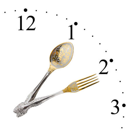 Clock made of spoon and fork isolated on white background photo