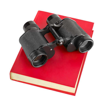 Book and binoculars isolated on white background photo