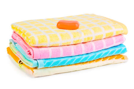 Towels and soap isolated on white background photo
